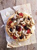 An artichoke, chorizo and black olive pizza