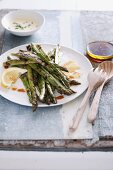Grilled asparagus with sauce