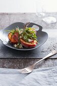 Grilled peaches with ham and rocket
