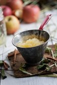 Apple sauce in a funnel