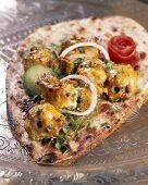 Kasturi Kebabs (grilled chicken kebabs, India) on naan bread