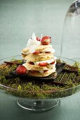 Strawberry shortcake on a bed of moss in a glass dish