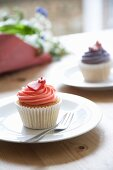 Vanilla cupcake with strawberry cream decorated with a heart