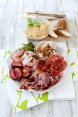 A meat platter with onion spread and hummus for Christmas dinner