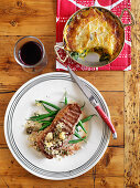 Steak with capers and green beans, with pumpkin and spinach gratin