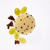 Wine foam ice cream with chocolate pieces, green grapes and grated chocolate