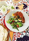 Doro Wot (an Ethiopian chicken dish) with chapatis
