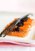 Salmon sashimi with vanilla and vodka dressing and caviar