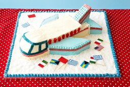 An aeroplane cake with various flags