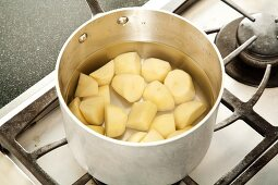 Peeled and Chopped Potatoes in a Pot of Water for Boiling