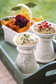 A dish of aubergine and tahini dip and a dish of aubergine and yoghurt dip