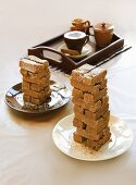 Stacks of shortbread fingers and a cup of cappuccino