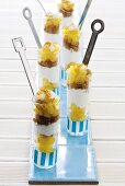 A layered summery dessert with apples, spiced breadcrumbs and cream