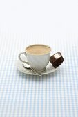 A cup of coffee with an ice cream brownie