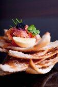 Smoke salmon tartar with lumpfish caviar on Melba toast