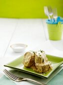 Pork tenderloin with a mustard and sour cream sauce and sage