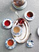 Various types of tea and tea cherries