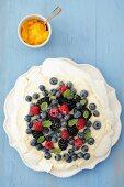 Pavlova with lemon cream and berries