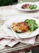 Hash browns with corned beef and spinach salad