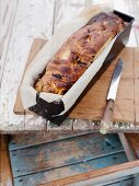 Bread in a loaf pan with olives and dried tomatoes