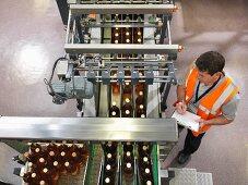 Factory worker in bottling plant