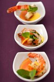 Bowls of antipasti: mango and scampi with coriander dressing