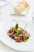 Veal carpaccio with tuna and capers