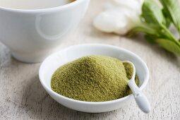 Matcha tea powder in a small dish