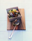 Venus clams with red onions, cucumber and parsley