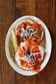 A Bagel with Lox, Capers and Red Onion; Pickle Spears