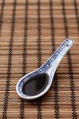 Soy sauce in an Oriental spoon