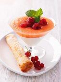 Melon and yogurt cream with a redcurrant cigar