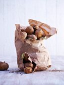 New potatoes in a torn paper sack