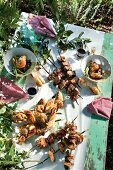 Barbecued kebabs on bay twigs