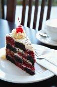 A slice of checked red velvet cake