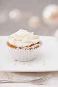 A wintry cupcake with white frosting