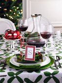 A Christmas place setting and red wine