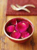 Rose petals in a bowl of water