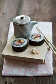 Maki sushi with tuna, egg, cucumber and crab