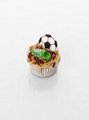 A caramel cupcake decorated with football motifs