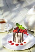 Fresh berries in a chocolate cup