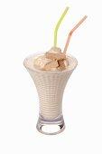 An ice cream shake with straws