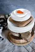 Salmon caviar on a stack of crockery