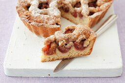 Yeast cake with plums, sliced