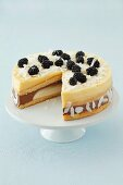 Banana, chocolate and pineapple mousse tart with blackberries and coconut