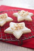 Three Macadamia Eggnog Cream Star Cookies on a Cooling Rack