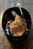 Roasted leg of wild boar with garlic