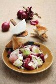 Onion salad with leek, ricotta and toast