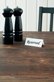 Salt and pepper mills and reserved sign