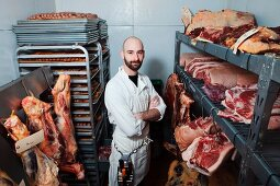 Butcher in meat storage area
